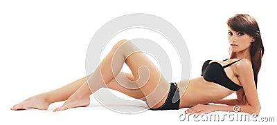 Odizolowywająca nad biel młoda seksowna brunetka