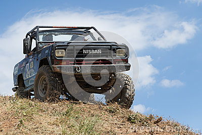 off road car and blue sky in the background editorial photography. Black Bedroom Furniture Sets. Home Design Ideas