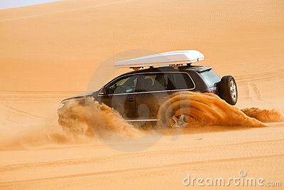 Off-road car fetching a dune, Libya - Africa