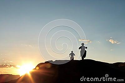 Off road motor bikers at sunset