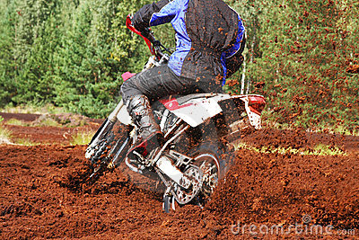 Off-road motorbike cornering in dirt