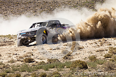 Off Road Truck Race with Dust Plume