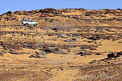 Off-road vehicle on a rough desert road
