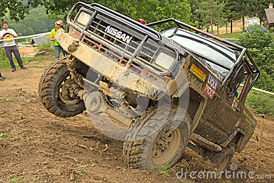 Off-road vehicle on top of a steep hill Editorial Stock Image