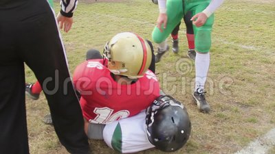 Offense team using violent physical force to tackle defense player, injury risk. Stock footage stock footage