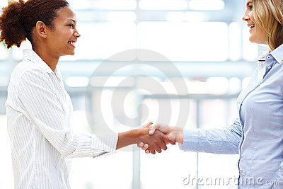 Office associates shaking hands with eachother