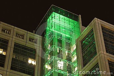 Office building at night with green lights