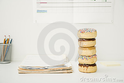 Office Desk With Stack of Donuts