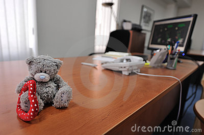 Office Desk With a Teddy Bear