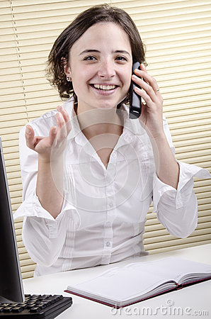 Office employee during a phone conversation