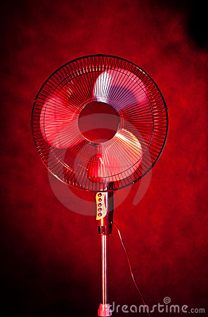 Office fan on dark red background