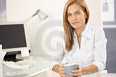 Office girl enjoying coffee break