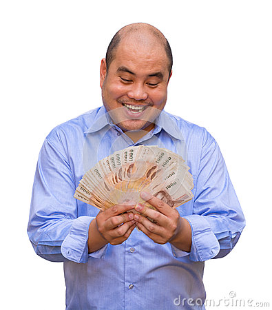 An office guy holding pile of Thai banknotes with