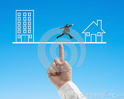 Office and home on seesaw with one businessman running