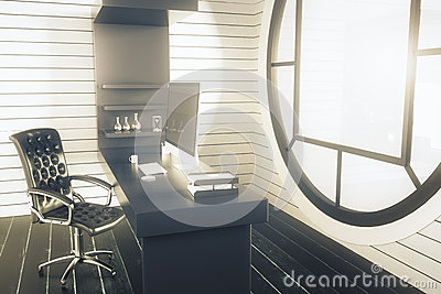 Side view of office interior with swivel chair dark desk with