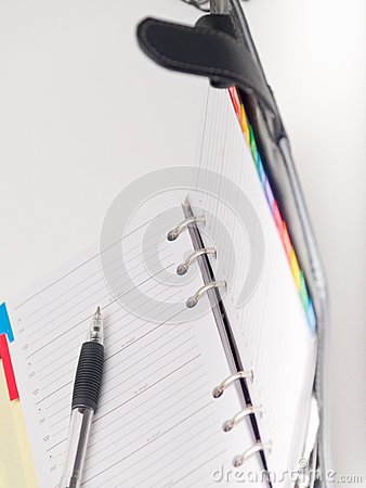 Office stationary - Pen and diary on white