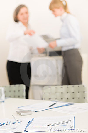 Office supply - two business women discussing