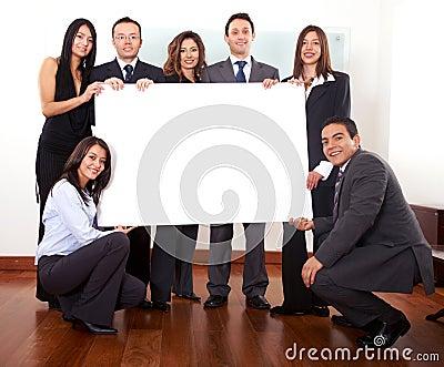 Office team holding a cardboard