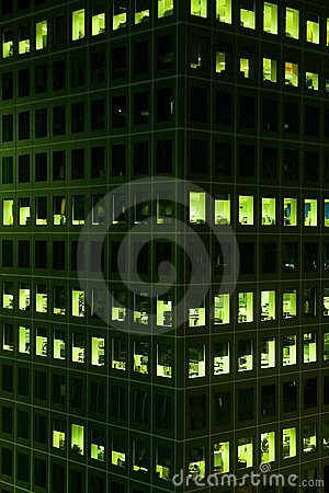 Office windows lit at night