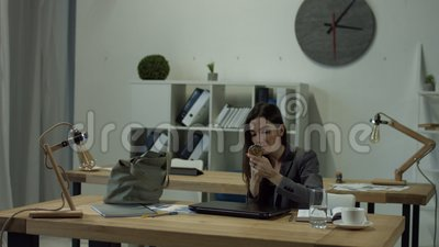 Office woman finished her work and going home stock footage