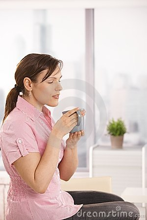 Office worker enjoying her tea