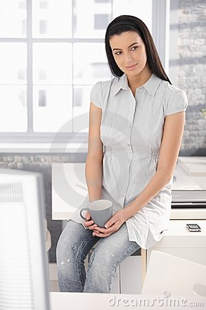 Office worker girl on coffee break