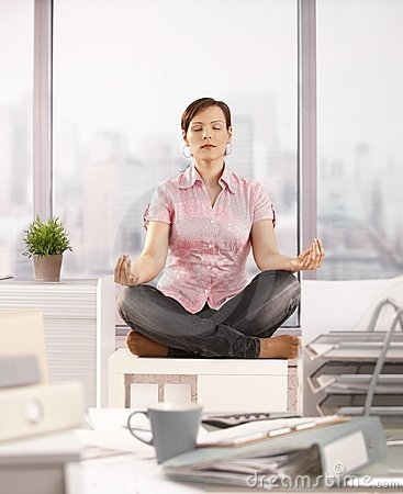Office worker meditating