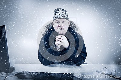 Businessman in a Cold Office with Snow and Ice
