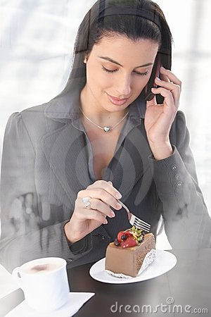 Office worker on phone call in cafe