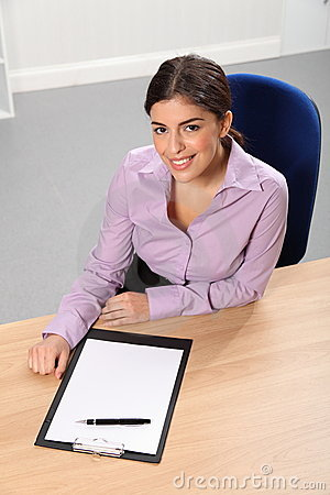Office worker woman at desk with pen and paper