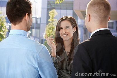 Office workers chatting at break time