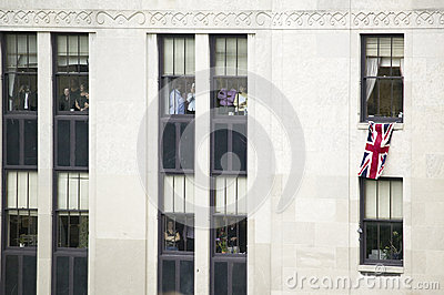 Office workers hanging Union Jack British Flag Editorial Image