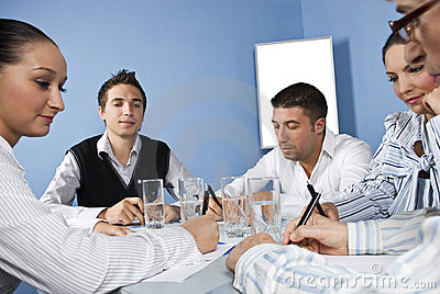 Office workers in the middle of business meeting
