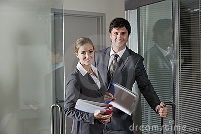 Office workers opening boardroom door
