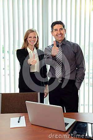 Office Workers Showing the Thumbs Up