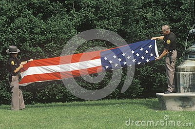Officers Folding the American Flag Editorial Stock Photo