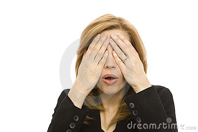 Officewoman covers her eyes