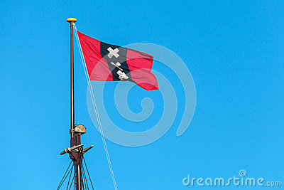 The official Amsterdam flag on top of the mast of a sailship