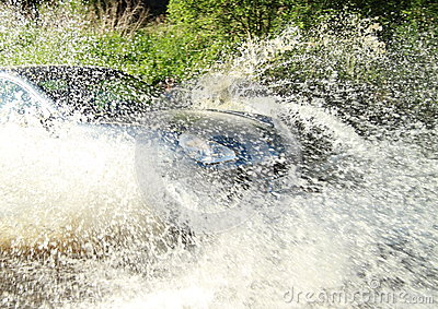 Offroad car splashing water