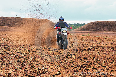 Offroad motorbike driving in dirt.