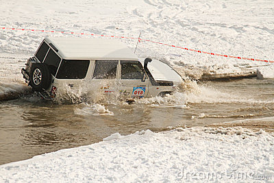 Offroad race car in the river of winter season Editorial Photography