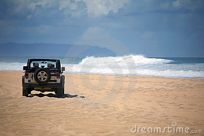 Offroad Vehicle on a Remote Beach in Hawaii