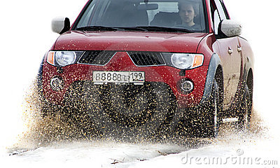 Offroad vehicle running through mud