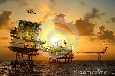 Offshore construction platform for production oil and gas. Oil and gas industry and hard work. Production platform and operation Stock Photo