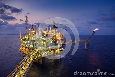 Offshore oil and gas central processing platform produced gas and crude then sent to onshore refinery Stock Photo