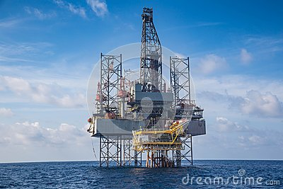 Offshore oil and gas drilling rig at the gulf of Thailand whil compleation on wellhead remote platform Stock Photo
