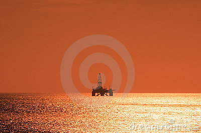 Offshore oil rig during sunset