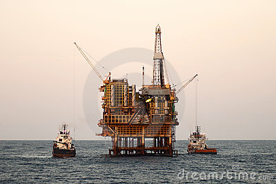 Offshore  oil rig with supply boats.