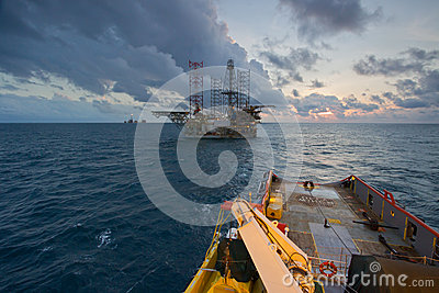 An offshore vessel during towing operation of an oil platform