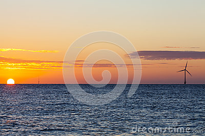 Offshore wind turbine at sunrise
